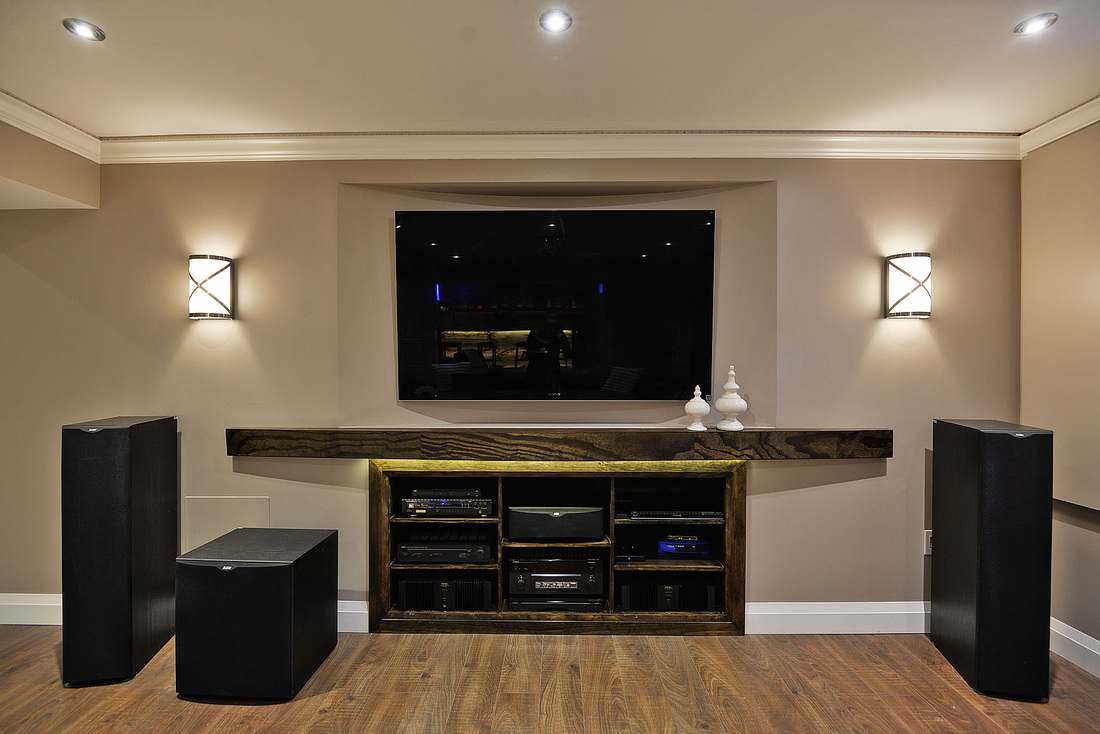 Home theatre with 11.5 speakers in basement