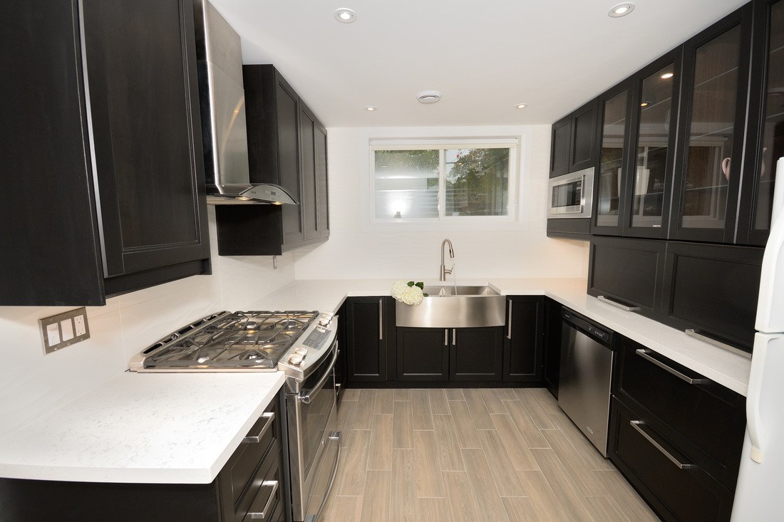Modern Kitchen with black cabinets